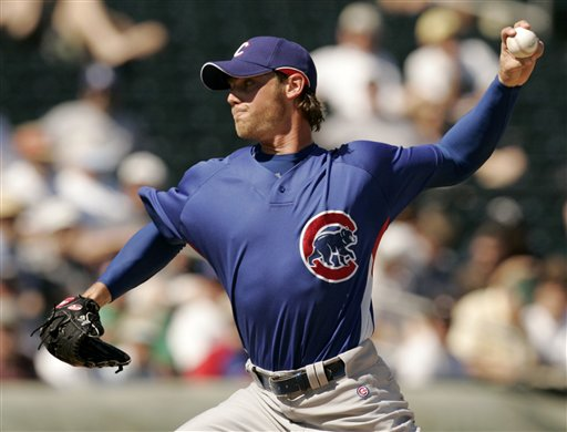 Neal Cotts Pitches Against the Texas Rangers in Spring Training