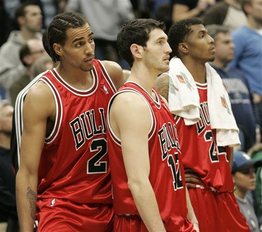 Chicago Bulls forward Thabo Sefolosha (2), guard Kirk Hinrich (12), and forward Tyrus Thomas (24) look on from the bench in the final seconds of their 109-108 loss to the Minnesota Timberwolves in overtime in an NBA basketball game, Sunday, Jan. 25, 2009 in Minneapolis. (AP Photo/Paul Battaglia)