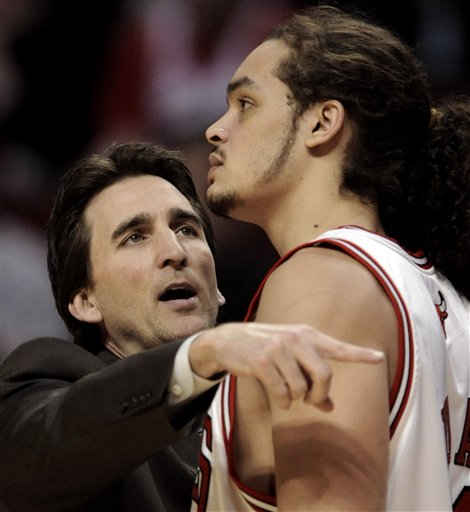 Chicago Bulls Head Coach Vinny Del Negro, left, talks with Joakim Noah in the fourth quarter of an NBA basketball game against the Sacramento Kings in Chicago, Tuesday, Jan. 6, 2009. Chicago won the game 99-94. (AP Photo/Paul Beaty)